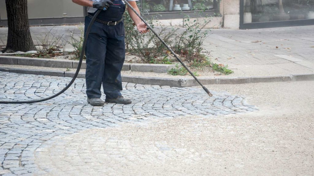 Power Washing Bricks Outside A Property - Property Management Cleaning
