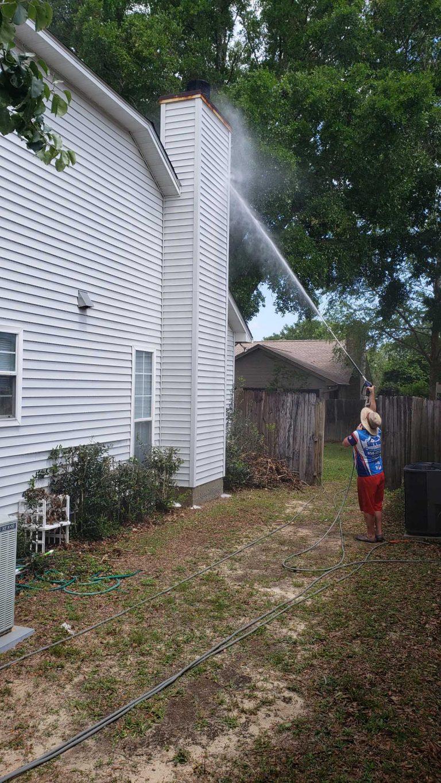 Man Power Washing Chimney - Pressure Washing
