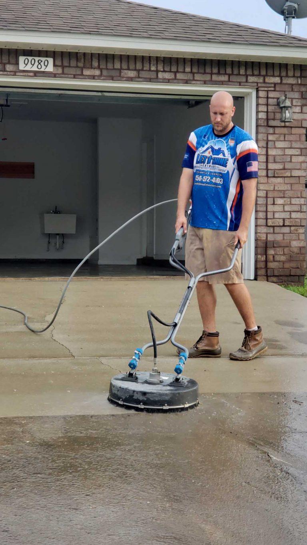 Man Power Washing Driveway - Pressure Washing