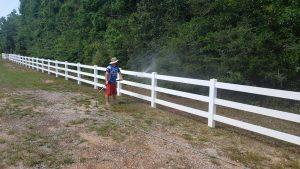 Man Power Washing Fence - Pressure Washing