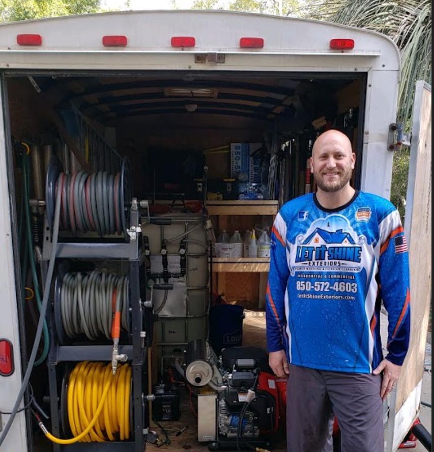 Chris behind his Pressure Washing Truck